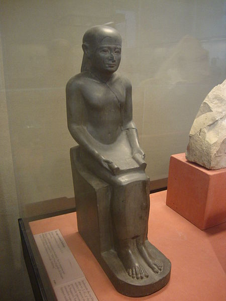 A statue of imhotep in the Louvre. It is the Largest of the three statues of Imhotep in the Louve all with the same pose. Photo taken by Dr Nigel Hawkins.